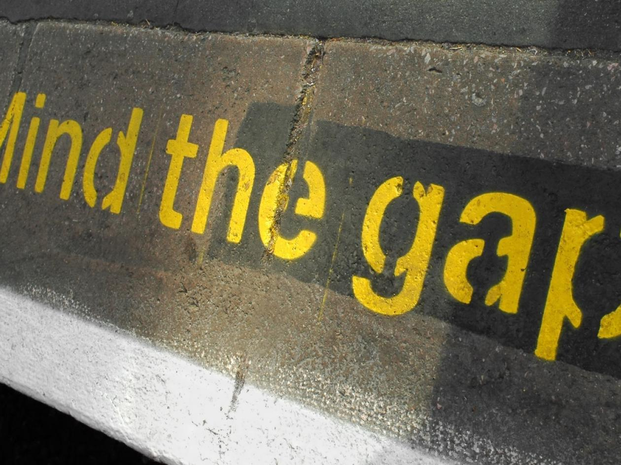 the words 'mind the gap' at a tube station