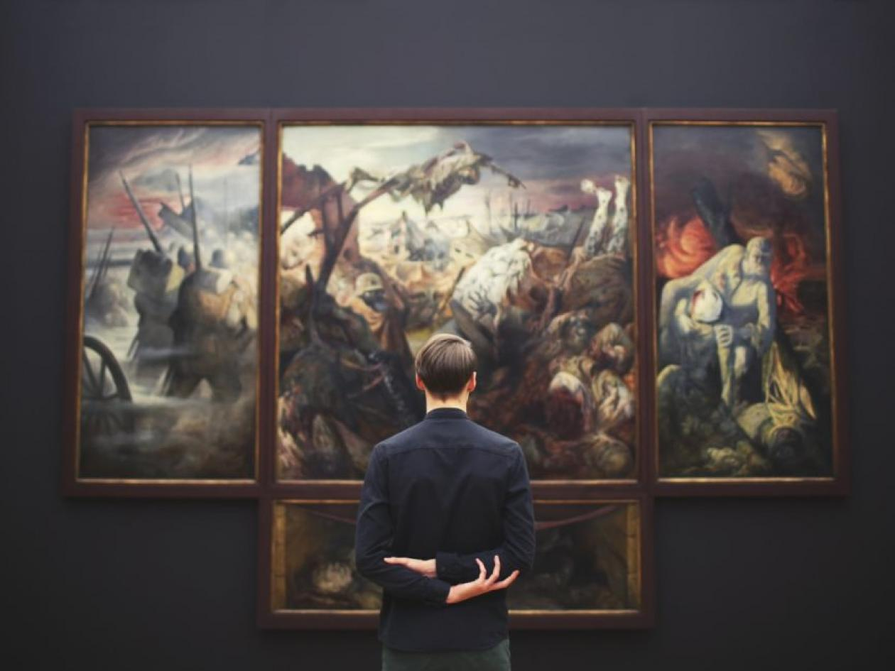 Man standing in front of an artwork