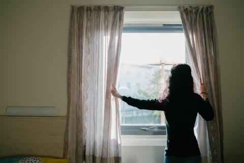 Women standing at a window
